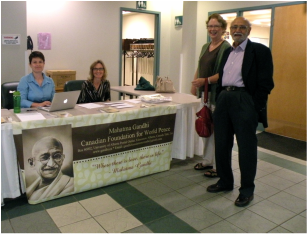 photo of Foundation members at the welcome table of the 2014 Annual General Meeting