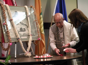 photo of peace candle lighting at annual memorial event 2012